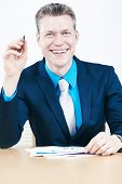 Smiling businessman with paperwork