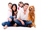 stock photo of bonding  - Happy family with a dog  - JPG