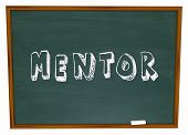 The word Mentor on a school chalkboard to illustrate a relationship between a teacher and student, a
