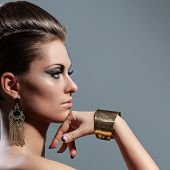 Beautiful young caucasian  woman with evening makeup and hairstyle