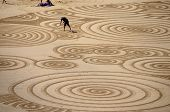 Man creating sand art