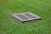 Sewer Grate On The Lawn - Drainage For Heavy Rain