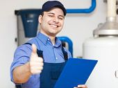 picture of pipefitter  - Young plumber with thumbs up - JPG
