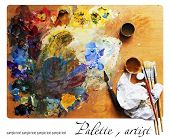 Palette with paintbrushs and palette-knife