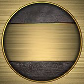 gold circle with the texture of the wood and gold plate