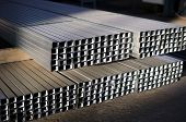 stock photo of tin man  - tin sheet metal profiles in production hall - JPG