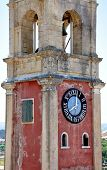 Old tower and clock in the town of Corfu, Greece, Europe