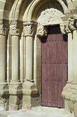 detail of the entrance to the Romanesque church of Santiago, aguero, Spain