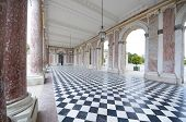 stock photo of taper  - colonnaded courtyard at the Grand Trianon in Palace  Versailles - JPG