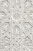 picture of symmetrical  - closeup of a wall of white plaster Arabic - JPG