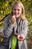 Happy Woman Just To Taste A Lingonberry