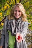 Happy Woman Who Offers Lingonberry