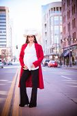 picture of baby cowboy  - Beautiful expectant mother to be pregnant woman cowgirl in urban setting wearing a cowboy hat - JPG