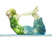 Combining nature with spiritual yoga in a creative portrait of a young woman lying with her body arc