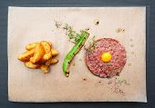 Beef tartare with french fries and avocado shot from above