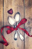 Valentines Day spoons tied with romantic red ribbon
