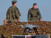 KIEV, UKRAINE -NOV 3: Quadrocopter drone flies with mounted digital camera during historical reenact