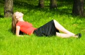 foto of country girl  - Young beauty woman resting on green grass - JPG