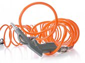 Air compressor gun with coiled orange hose shot on white