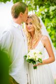 Married couple, bride and groom getting married, Tropical wedding in Hawaii