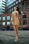 Model posing in designer mini dress at historical area