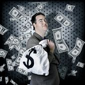 Business Man In Bank Vault With Finance Money Bag