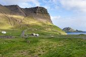 Scenic Road Running Through Mountains Of Faroe Islands