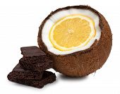 Lemon Inside Coconut And Pieces Of Chocolate Isolated On White