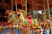 image of carousel horse  - brightly painted horses on a fairground carousel - JPG