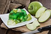 stock photo of jello  - Portion of Apple Jello on a plate - JPG