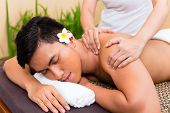 Indonesian Asian man in wellness beauty spa having aroma therapy massage with essential oil, looking