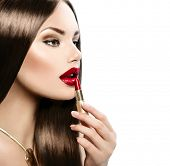 Red Lipstick. Professional Perfect Make-up. Makeup. Lipgloss. Beauty Girl Applying Lip stick. Beauti