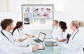 Team Of Doctors Looking At Projector Screen
