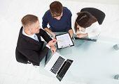 Financial Advisor Explaining Investment Plan To Couple