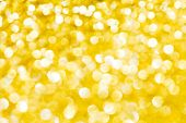 Abstract holidays golden lights on background
