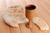 foto of covenant  - Cup of wine and bread on table close - JPG