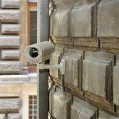 Surveillance Camera On Brick Wall