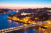 stock photo of dom  - Porto Cityscape Portugal at dusk with Dom Luiz bridge - JPG