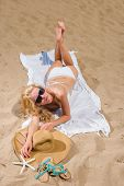 woman with beautiful white sarong on tropical beach