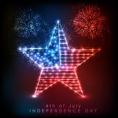 Shiny star in national flag colors in colorful fireworks night background, celebration background fo