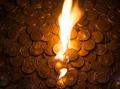 Fire burning on euro coins