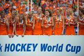THE HAGUE, NETHERLANDS - JUNE 14: The Netherlands women field hockey team celebrates on the podium d