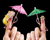 Caricature made of a finger puppet representing a happy couple