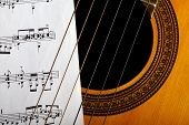 stock photo of musical scale  - A classical guitar and a music sheet.