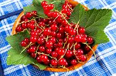 Red Currant In A Wooden Bowl