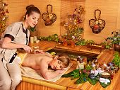 Woman getting relax massage in  spa resort.