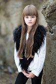 Portrait Of Little Girl Outdoors In Autumn