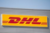 VALENCIA, SPAIN - JUNE 15, 2014: A DHL company sign at its depot in Valencia. DHL is a world wide co