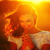 picture of sun god  - A young girl prays at sunset rays - JPG