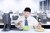 Overweight Businessman Avoid Junk Food